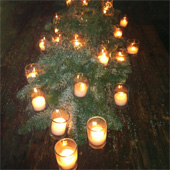 Jens Jakobson Christmas: tealights and evergreen full table arrangement